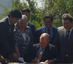 Jerry Brown signing SB 32 and AB 197